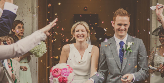 bride and groom showered with confetti, Hackney Town Hall wedding, Photographer wedding eastLondon, Documentary wedding photographer London, Photojournalist wedding photographer London, South East London wedding photographer
