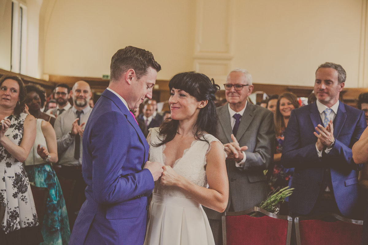 Reportage wedding photographer south london, dulwich college wedding, bride and groom fist bumping London wedding, london wedding photographer